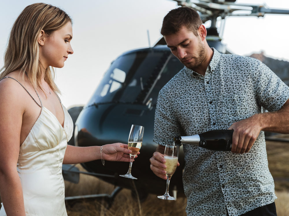 couple champagne helicopter